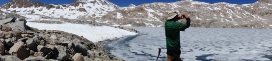 cocopelli near a frozen lake on top of muir pass
