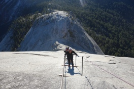 climbing down half dome. we were the 6th ones up there and beat the crowd. wouldnt want to climb this with 100 other people trying to do it too.
