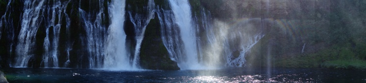 Burney Falls. The small falls are springs popping out of the rock. = cold swimming.