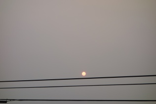 The sun poking through the haze created by the forest fires.