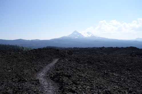 lava fields created from the sisters wilderness. a really unreal and spectacular place to be able to hike. north sister in the distance